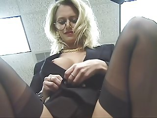 Office chick strips and spreads her thighs
