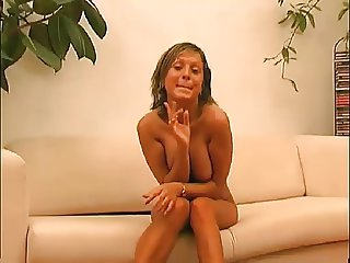 attractive lady strips on sofa