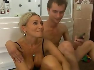 Stunning mature women and boy in shower