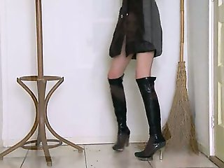 sucking witch in high black boots
