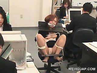 Japanese babe gets roped to her office chair and fucked