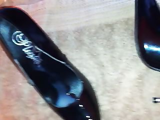 Cum into shiny black shoes on instruction from web babe