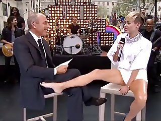 miley cyrus plays footsie