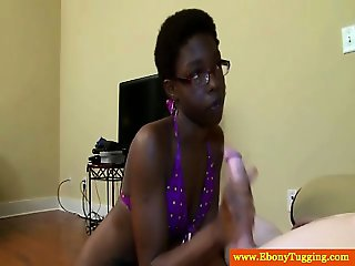 Ebony in spex tugging on dick for this lucky guy