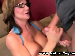 Brunette mature tugging his hard cock