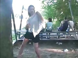 Teen flashing and stripping behind people