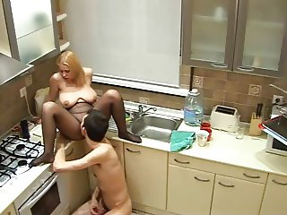 Playing With Wife On Kitchen Counter
