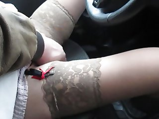 Touching her between legs in stockings in a car
