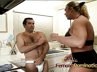 Angry dominatrix with big muscles hurts her husband