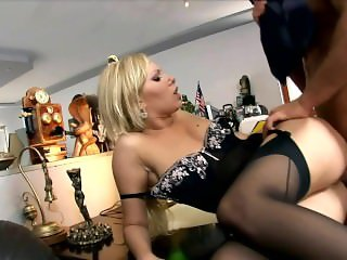 Blonde secretary Donna Bell fucked in black seamed stockings and a garter