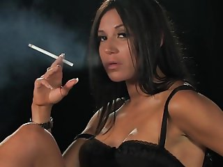Smoking brunette posing