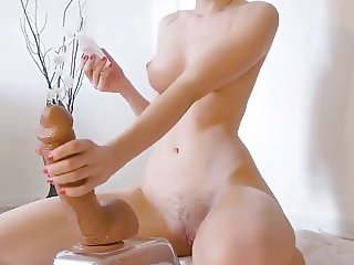 Teen Rides Massive Dildo on Cam