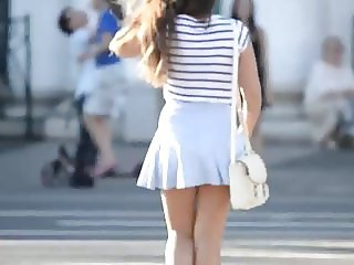 Delicious tourist in light blue skirt