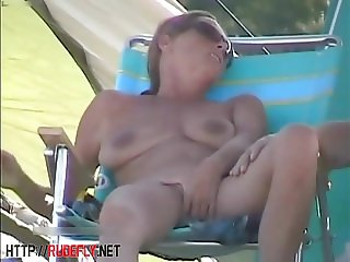 Amazing nudity of some babes on the beach