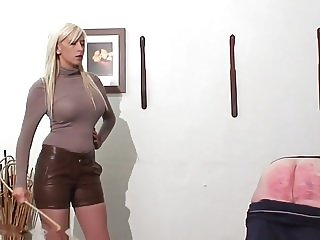 caning punishment by hot young blonde mistress in leather sh