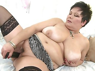 Hot mature mama with huge tits and hungry vagina