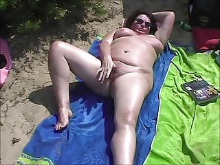 Mature touching on beach