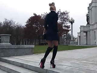 Hot teen in high heels boots, short skirt and nylon walking