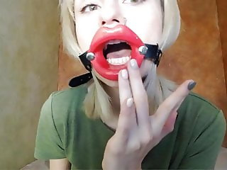 Zooming in red lips open mouth gag for dildo-blowjob.
