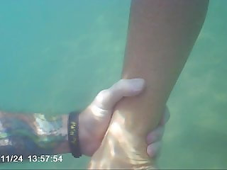 Fun in water at public beach, footjob with cum