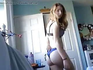 Girl undresses for camara
