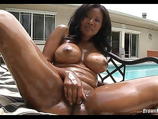 Oiled up babe by the pool