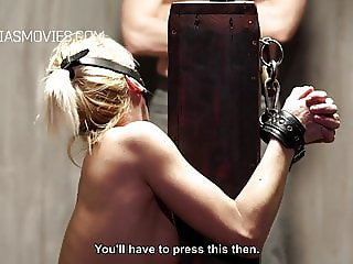 Helpless blonde slave whipped