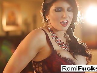 Smoking beauty Romi Rain takes care of her wet pussy