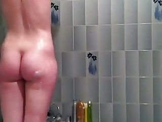 Voyeur - Cute redhead spied in the bathroom showering