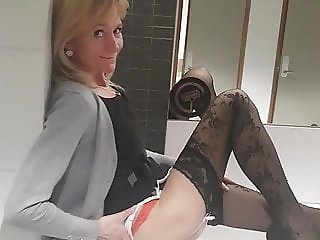 Skinny mature woman in the toilet