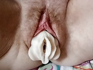 Rubber vagina in the pussy of a girl