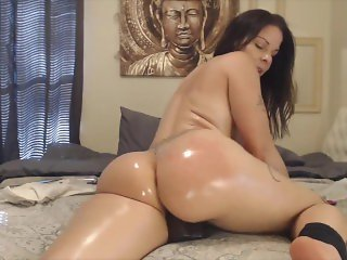 Playful big booty latina rides thick black dildo