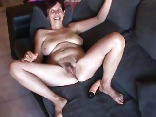 Nude Granny Cleans Up with Dildo