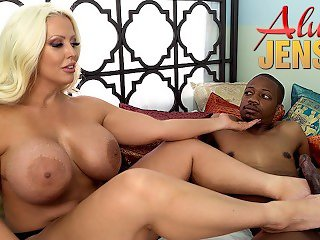 Alura Jenson jerks off a black cock with her feet