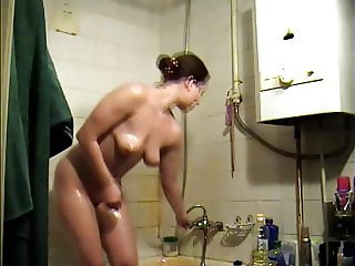 Super Hot Brunette takes a Shower-Spy Cam Clip