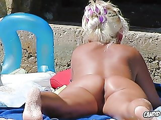 Sweaty and tannekd nudist ladies spied at  beach by voyeur