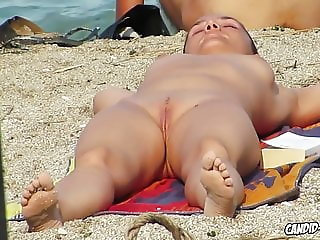 Hot and horny nudists having fun at beach spied by voyeurr