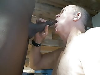 Grandpa on his knees sucking black cock