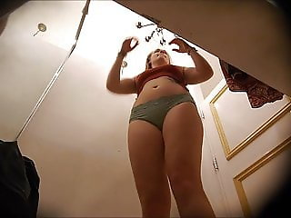 Spying on MILF with hairy pussy trying on clothes