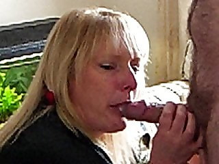 Amateur slutwife taking a mouthful whilst wanking another