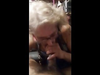 Toothless granny with glasses sucking dick and drink cum