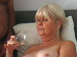 Granny fingers herself to orgasm and drinks my cum from a gl
