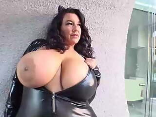 Busty BBW brunette in a tight, latex costume