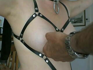 slave is punished with safety pins in tits