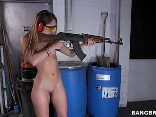 She sucks two guys at the shooting range