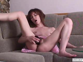 Fucking her hairy pussy with toy