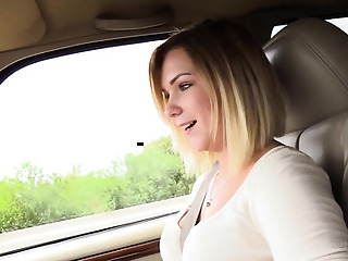 Cute blonde has sex in the car with an unfamiliar person