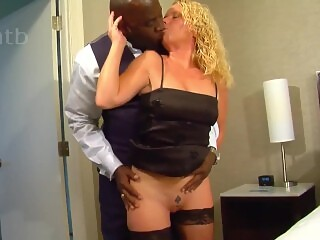 Sexy blonde wife enjoys BBC on vacation in a hotel