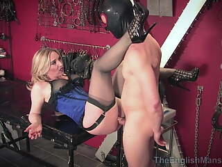 Mistress in corset & stockings teasing & using slave