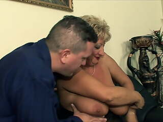 Huge tits mature fucked by two